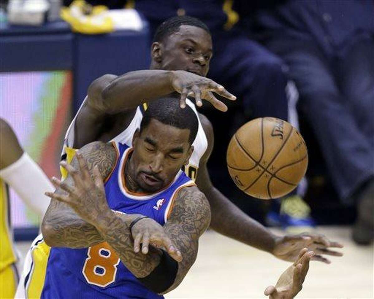 Indiana Pacers guard Lance Stephenson, top, fouls New York Knicks guard J.R. Smith during the second half of Game 4 of the Eastern Conference semifinal NBA basketball playoff series, in Indianapolis on Tuesday, May 14, 2013. The Pacers defeated the Knicks 93-82. (AP Photo/Michael Conroy)