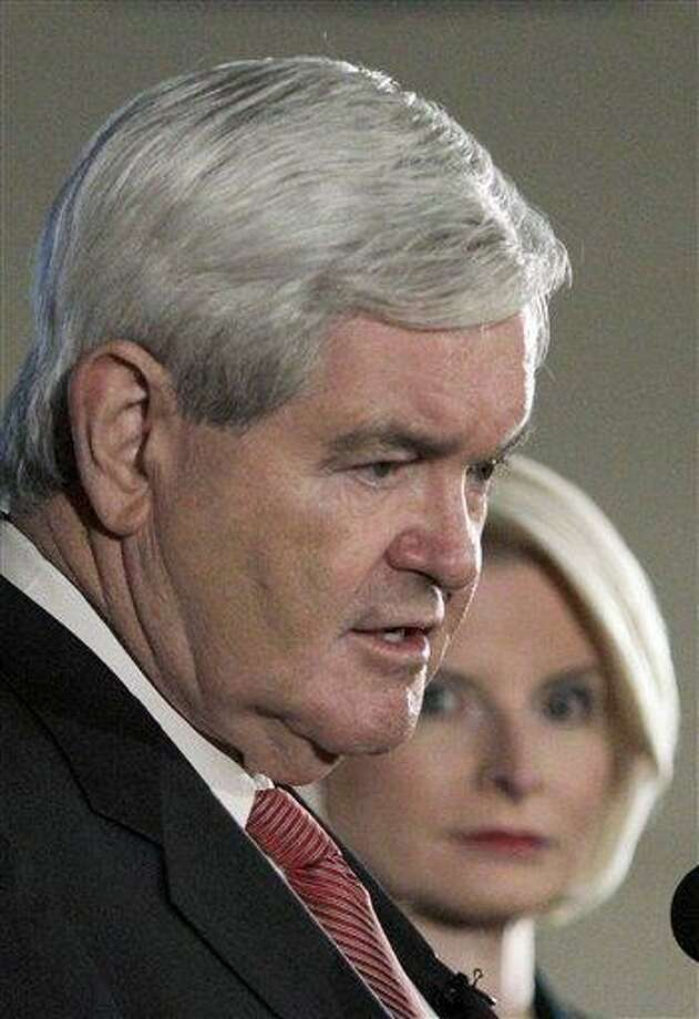 Republican presidential candidate and former House Speaker Newt Gingrich, accompanied by his wife Callista, speaks at a campaign stop in Manchester, N.H., earlier this week. Associated Press Photo: ASSOCIATED PRESS / AP2012