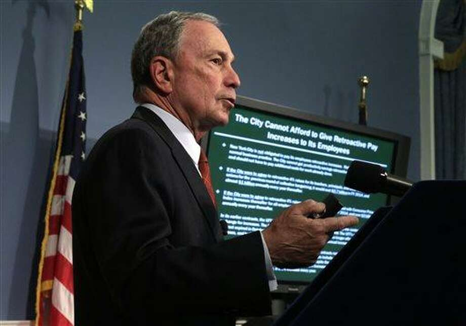 New York Mayor Michael Bloomberg delivers the 2014 city budget in the Blue Room of New York's City Hall, Thursday, May 2, 2013. Bloomberg presented the budget for the fiscal year of 2014, the last one of his tenure. The presentation is just the beginning of a long negotiation process with the City Council and other stakeholders.(AP Photo/Richard Drew, Pool) Photo: AP / AP