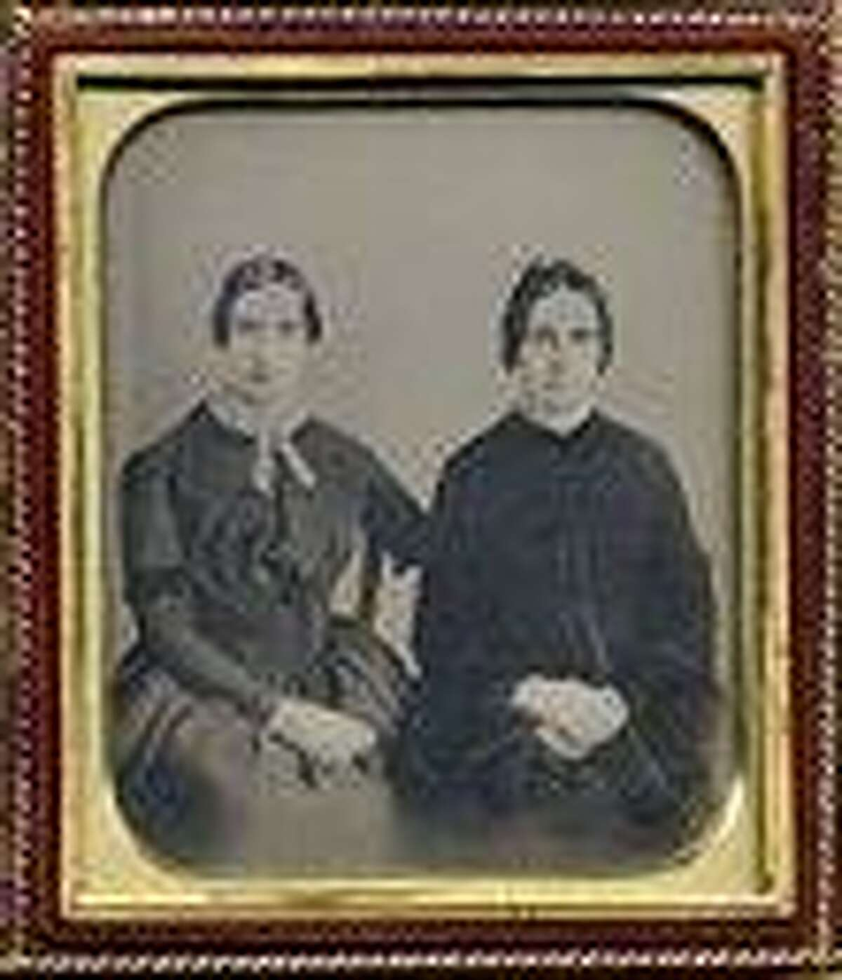This photo released Friday, Sept. 7, 2012 by Amherst College Archives and Special Collections, and the Emily Dickinson Museum, in Amherst, Mass., shows a copy of a circa 1860 daguerreotype purported to show a 30-year-old Emily Dickinson, left, with her friend Kate Scott Turner. The image was displayed during the August, 2012 Emily Dickinson International Society conference held at at Case Western Reserve University in Cleveland. (AP Photo/Amherst College Archives and Special Collections, and the Emily Dickinson Museum)