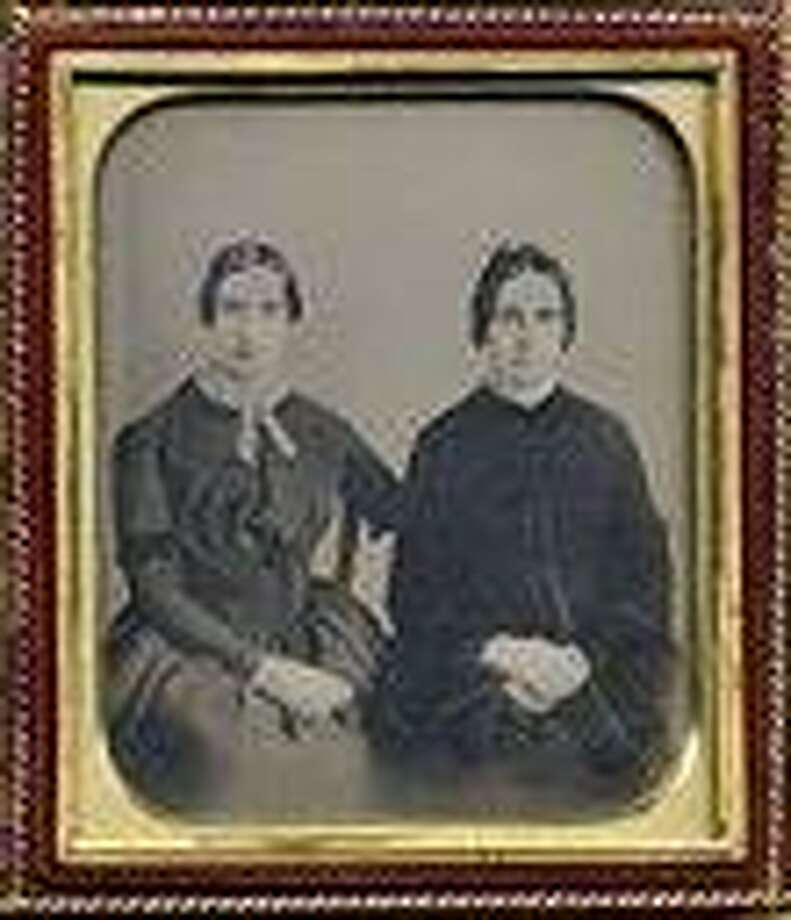 This photo released Friday, Sept. 7, 2012 by Amherst College Archives and Special Collections, and the Emily Dickinson Museum, in Amherst, Mass., shows a copy of a circa 1860 daguerreotype purported to show a 30-year-old Emily Dickinson, left, with her friend Kate Scott Turner. The image was displayed during the August, 2012 Emily Dickinson International Society conference held at at Case Western Reserve University in Cleveland.  (AP Photo/Amherst College Archives and Special Collections, and the Emily Dickinson Museum) Photo: AP / Amherst College