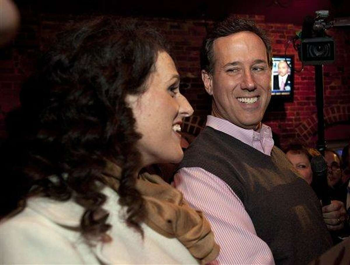 Republican presidential candidate and former Pennsylvania Sen. Rick Santorum smiles at his daughter, Elizabeth, during a campaign rally in Manchester, N.H., earlier this week. Associated Press
