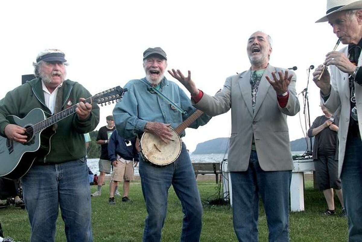 Folk singer Pete Seeger is shown leading a sing along on the banks of the Hudson River in Croton Point Park in Croton-on-Hudson, New York.