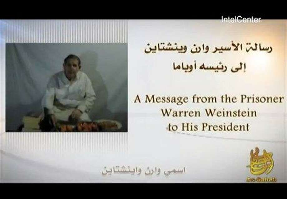 In an image provided by IntelCenter, a still from the video released Sunday by al-Qaida of American hostage Warren Weinstein. Weinstein said he will be killed unless President Barack Obama agrees to the militant group's demands. (Associated Press/IntelCenter) Photo: AP / IntelCenter