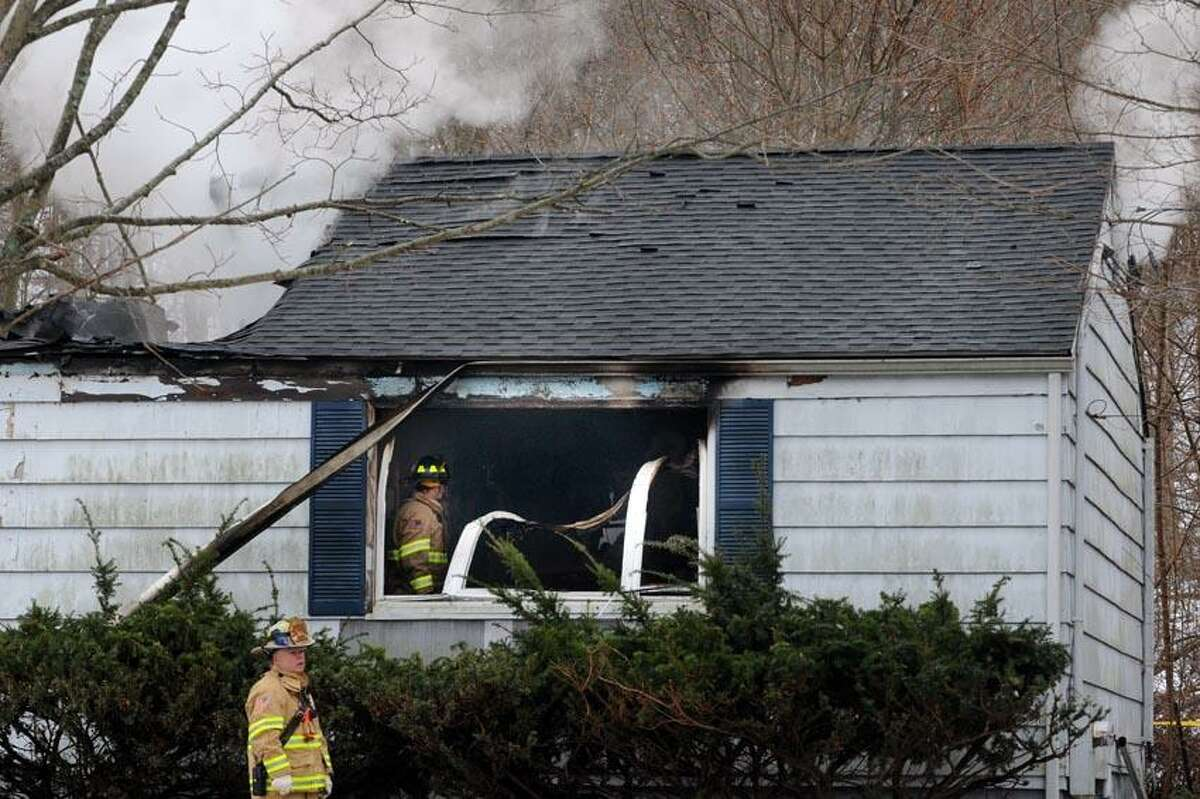 North Branford firefighters working to put out a fire on Pine View Drive in North Branford early Friday morning. VM Williams/Register