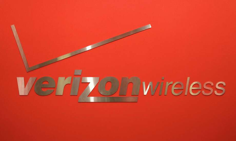 FILE - This Feb. 10, 2011, file photo, shows a Verizon Wireless logo at one of its stores in New York. Verizon Communications Inc. reported Thursday, April 19, 2012, a net income of $1.69 billion, or 59 cents per share, in the first three months of 2012, beating the average forecast of analysts by a penny per share. It was up from $1.44 billion, or 51 cents per share, a year ago. (AP Photo/Seth Wenig, File) Photo: AP / AP2011