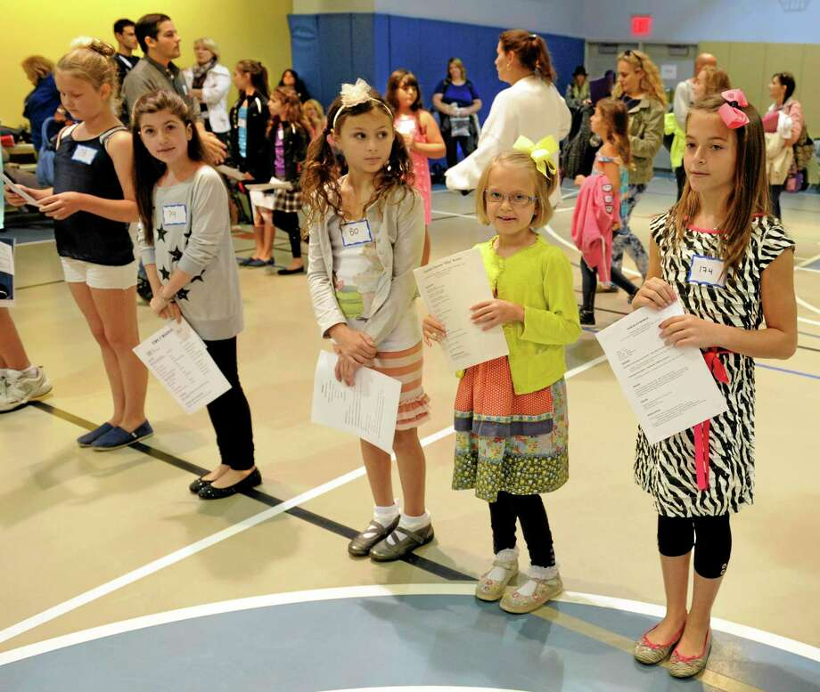 "This Sept. 15, 2013 image released by NBC shows a row of hopefuls at an open casting call for the Von Trapp children in NBC's ""The Sound of Music,"" at Grace Church School in New York. A remake of the 1965 film classic and the original 1959 Broadway production, starring Carrie Underwood and Stephen Moyer, will air on Dec. 5. (AP Photo/NBC, Virginia Sherwood) Photo: AP / Event"
