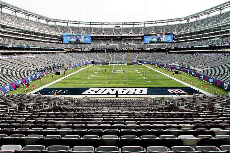 Tickets for premium seats at Super Bowl XLVIII at MetLife Stadium in East Rutherford, N.J., will be about $2,600 each. Photo: Peter Morgan — The Associated Press  / AP