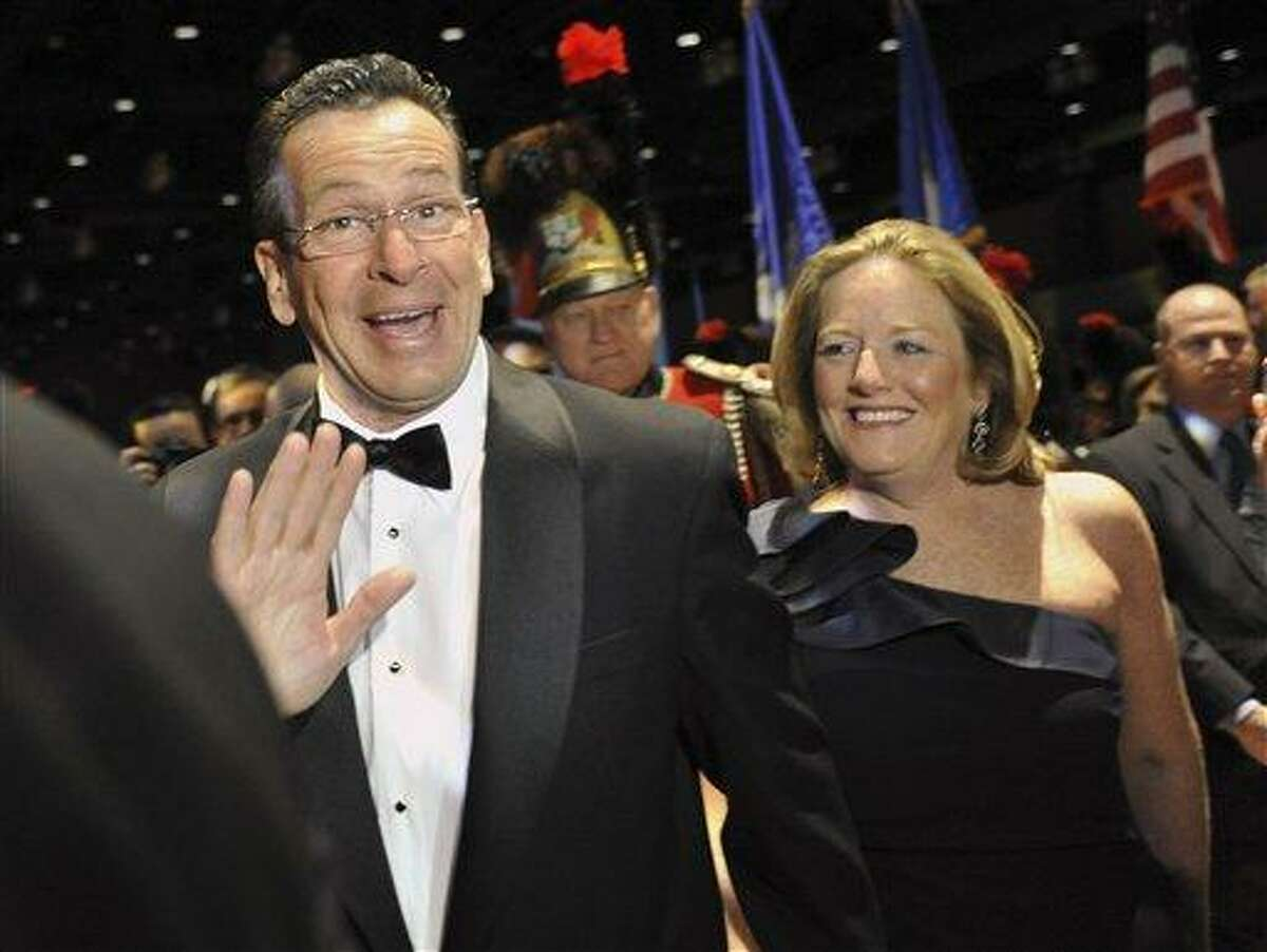 In this 2011 file photo, Gov. Daniel P. Malloy and his wife Cathy arrive at the Governor's Ball at the Connecticut Convention Center in Hartford. Cathy Malloy apologized Thursday for criticizing the media for scrutinizing elected officials to an extent that makes it harder to seek public office. Associated Press