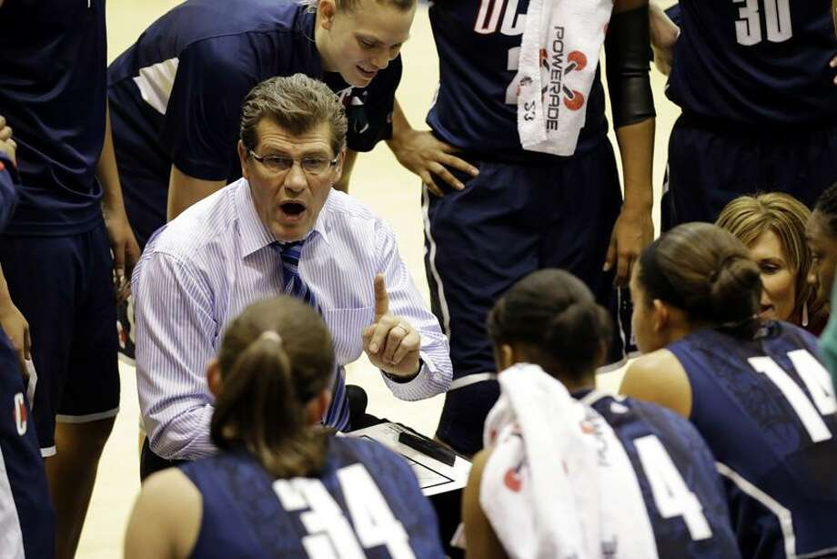 Connecticut head coach Geno Auriemma talks to his team during a timeout in the first half of an NCAA college basketball game against Georgetown, Wednesday, Jan. 9, 2013, in Washington. (AP Photo/Alex Brandon) Photo: AP / AP2013