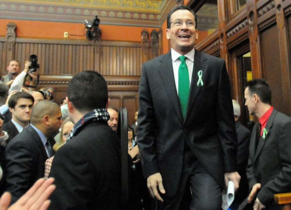 Connecticut Gov. Dannel P. Malloy enters the Hall of the House Wednesday to give the 2012 State of the State Address at the State Capitol in Hartford. In his speech, Malloy said,