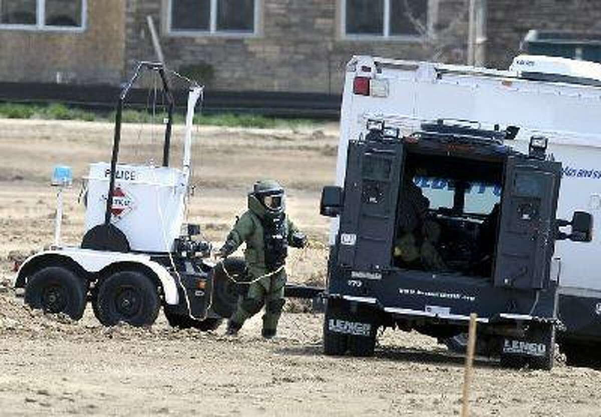 A police bomb squad member works to detonate a possible bomb found at Centaurus High School on Monday, May 13, 2013, in Lafayette. (Jeremy Papasso/Daily Camera)