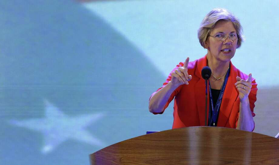 Senate candidate from Massachusetts Elizabeth Warren looks over the podium during a sound check at the Democratic National Convention in Charlotte, N.C., on Tuesday, Sept. 4, 2012. (AP Photo/J. Scott Applewhite) Photo: AP / AP