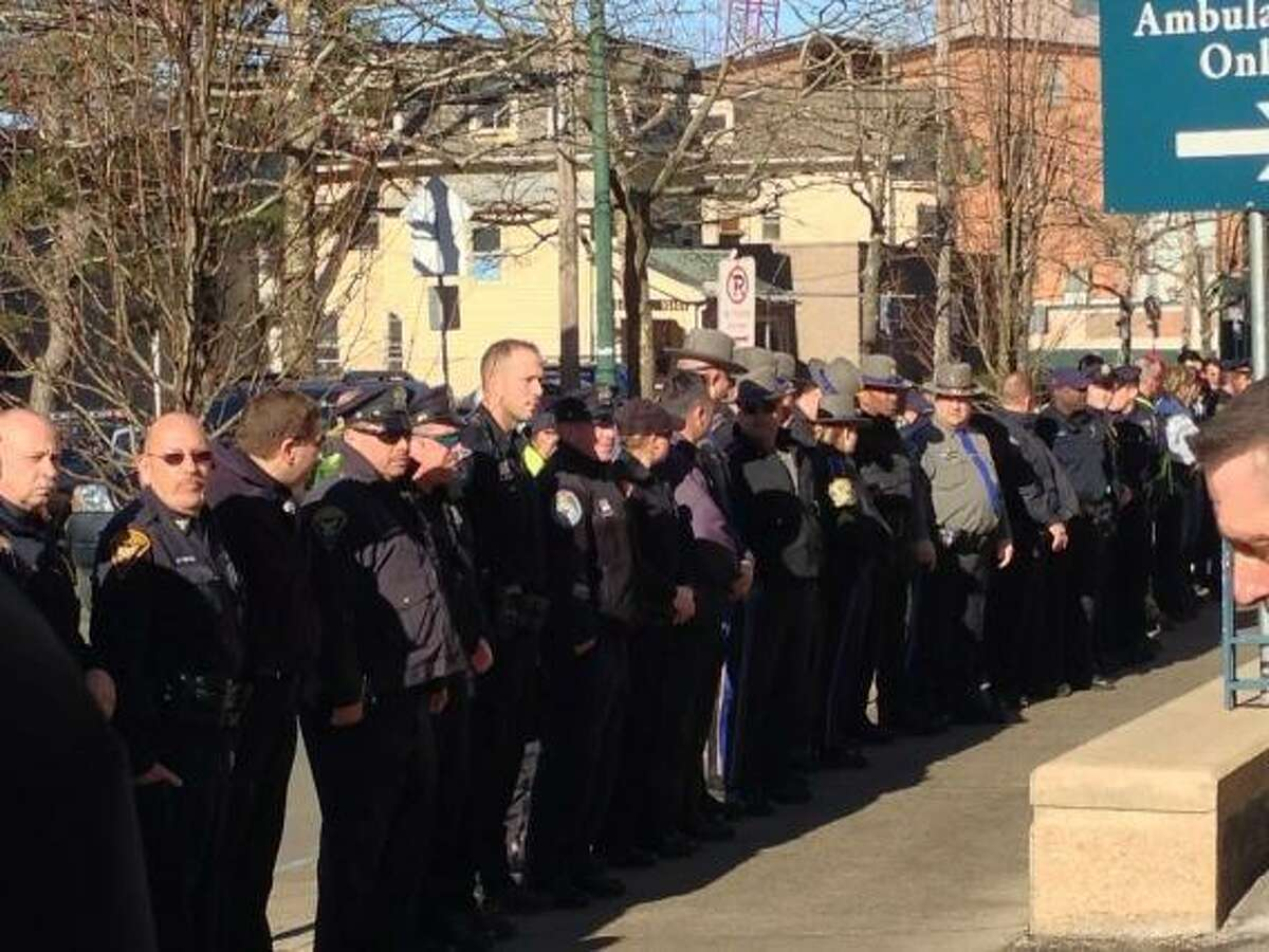 Officers line up outside Yale-New Haven Hospital waiting for injured Norwich Officer Jonathan Ley to be released Thursday. Rich Scinto/New Haven Register