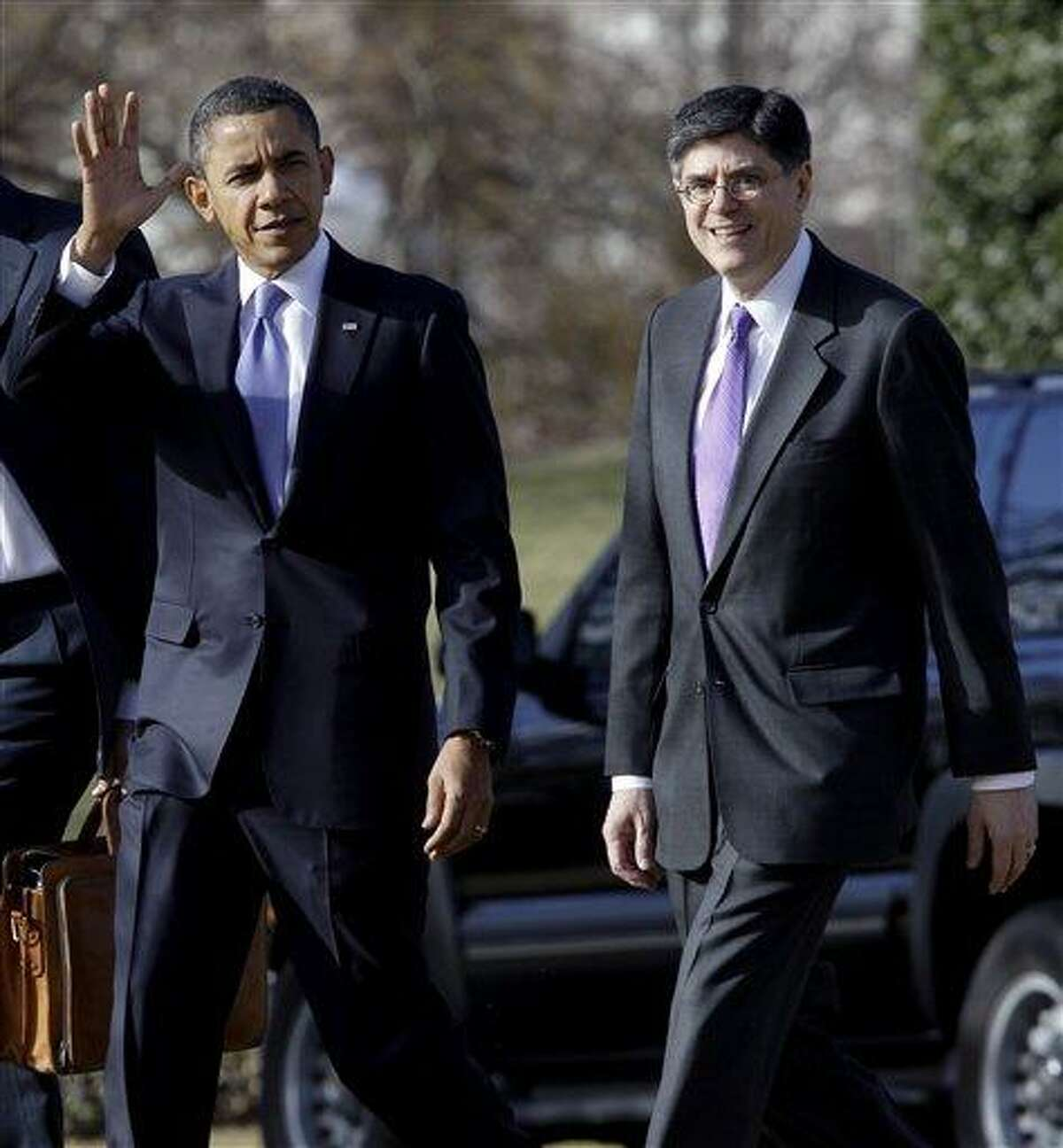 FILE - In this Feb. 14, 2011 file photo, President Barack Obama walks with Budget Director Jack Lew on the South Lawn of the White House in Washington. Two senior administration officials say the White House chief of staff, William Daley, is resigning. He's being replaced by Jacob Lew. (AP Photo/Charles Dharapak, File)