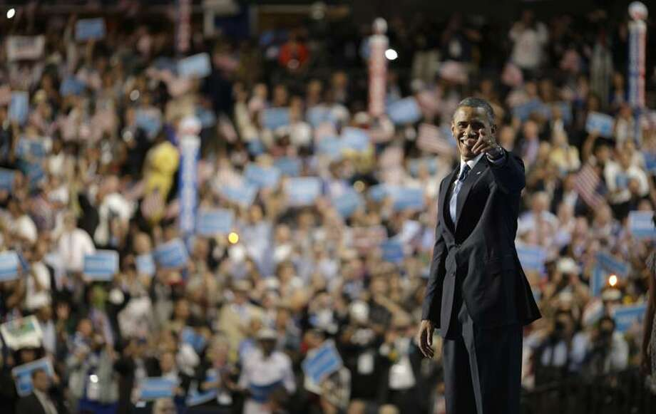 President Barack Obama waves after his speech at the Democratic National Convention in Charlotte, N.C., on Thursday, Sept. 6, 2012. (AP Photo/David Goldman) Photo: AP / AP