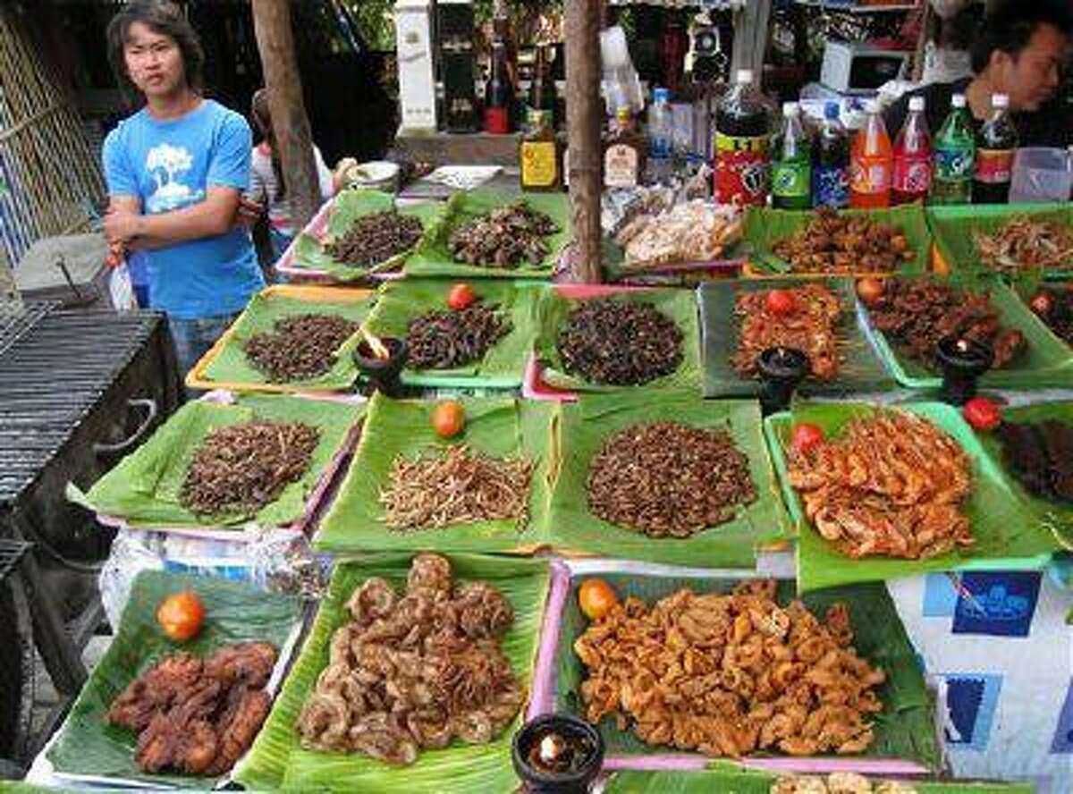 This Feb. 20, 2008 photo provided by the United Nations Food and Agriculture Organization (FAO) shows insects for sale at a market in Chiang Mai, Thailand. (AP Photo/Arnold Van Huis, FAO, ho)