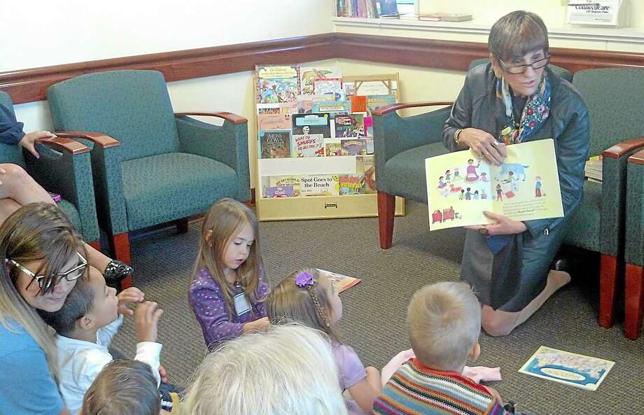 U.S. Rep. Rosa DeLauro reads to a group of children from the Town and Country Early Learning Center in support of Reach Out and Read in Middletown on Tuesday. Photo: Kaitlyn Schroyer — The Middletown Press