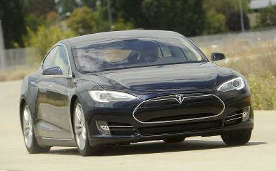 A Tesla Model S electric sedan is driven near the company's factory in Fremont, Calif., in this June 22, 2012 photo. The Model S is ten-year-old Tesla's first attempt to reach a mainstream audience for electric cars. Sales of the five-passenger sedan have outpaced expectations since its launch last year. Photo: REUTERS / X03026