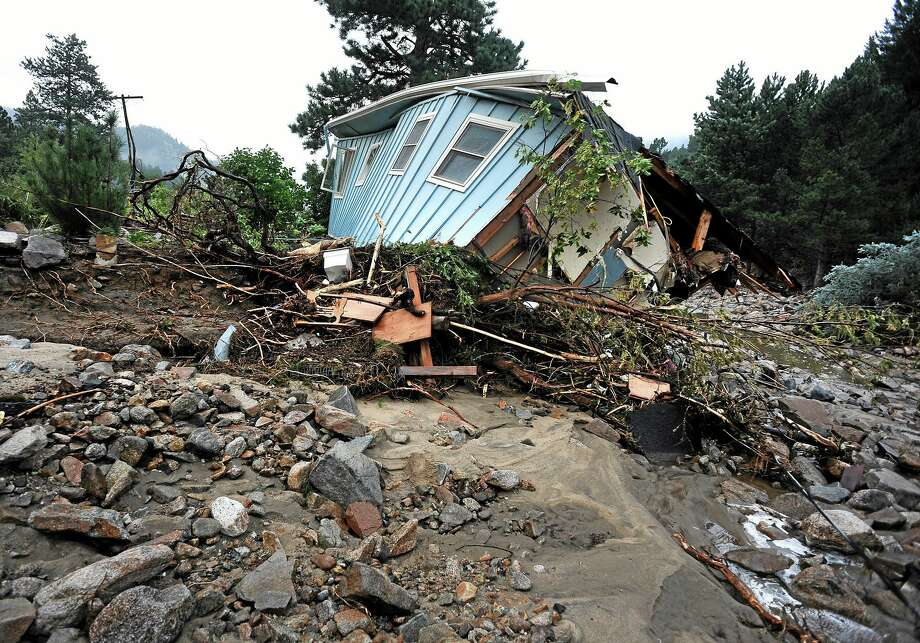 A house lays completely demolished in what was the path of the recent floods that have destroyed the town of Jamestown, Colo., on Sunday Sept. 14, 2013.  No one has been able to access the town until late Sunday afternoon when crews finalized repairs of the upper portion of the road for emergency traffic only.  The town has no infrastructure or running water.  Some parts of town amazingly enough have electricity.  A dozen or so residents stayed as most of the town was evacuated by helicopters. (AP Photo/ The Denver Post, Helen H. Richardson) Photo: AP / The Denver Post