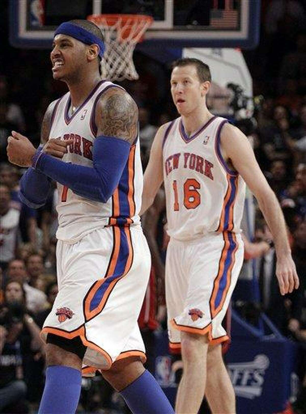 New York Knicks' Carmelo Anthony (7) and teammate Steve Novak (16) react during the second half of Game 4 of an NBA basketball first-round playoff series at Madison Square Garden, Sunday, May 6, 2012, in New York. The Knicks won the game 89-87. (AP Photo/Frank Franklin II)