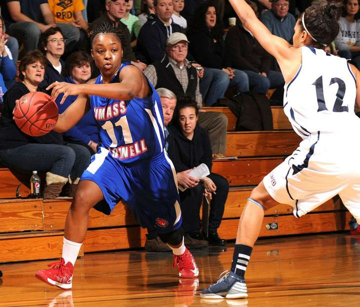 Gil Talbot/UMass Lowell Athletics Middletown's Bianca Simmons, a 2009 Mercy graduate, is currently leading Division II in scoring at 26.4 points per game.