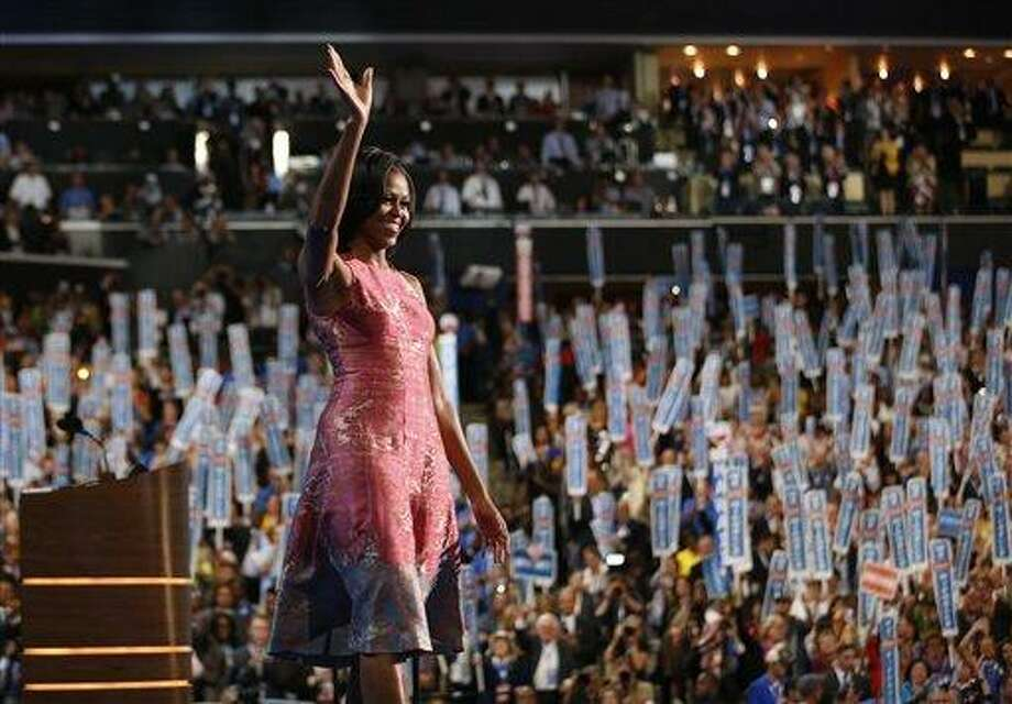 First lady Michelle Obama waves after addressing the Democratic National Convention Tuesday in Charlotte, N.C. Associated Press Photo: AP / AP