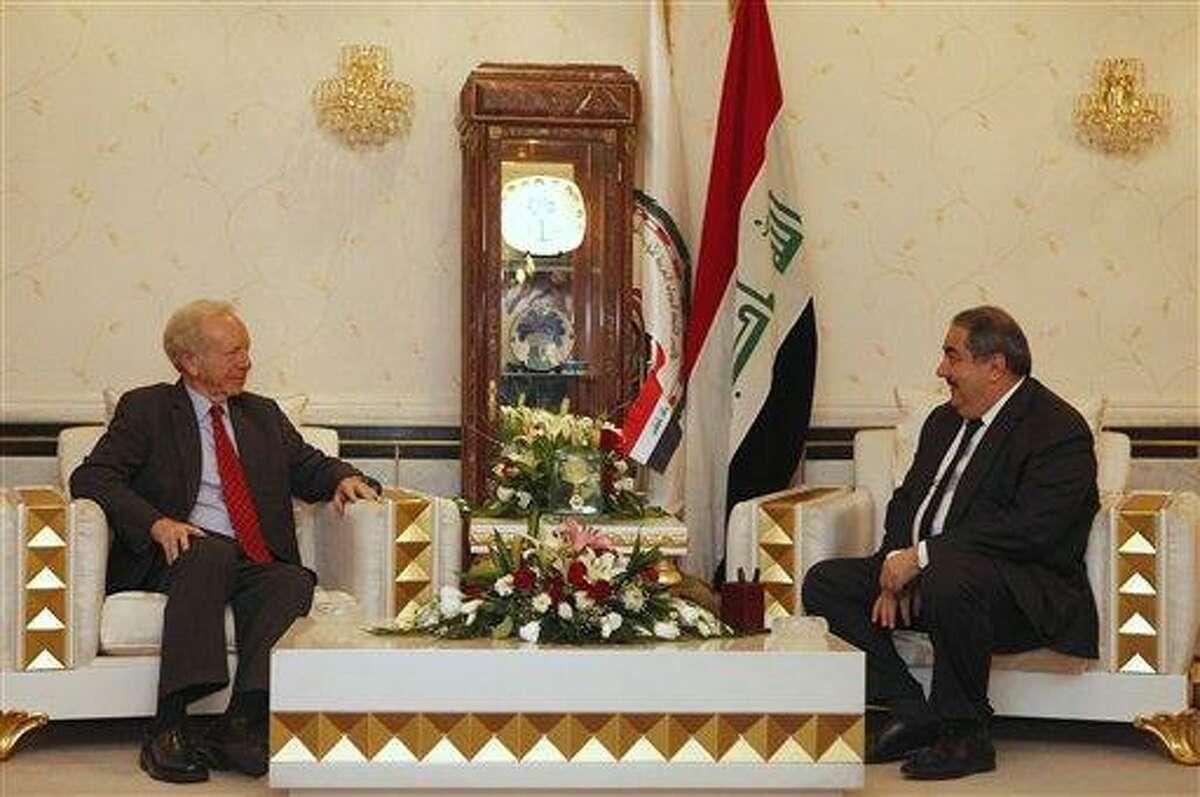 U.S. Sen. Joe Lieberman, left, meets with Iraqi Foreign Minister Hoshyar Zebari, right, Tuesday in Baghdad, Iraq. Associated Press