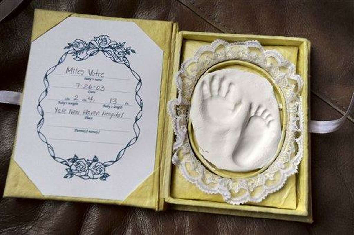 In this Wednesday, Dec. 28, 2011 photo, a hand and foot impression of Patricia Votre's son Miles are in a keepsake box in Woodbridge. Associated Press