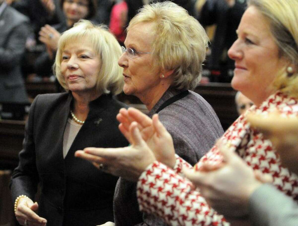 """Led by the applause of Cathy Malloy, wife of Governor Dannel P. Malloy, far right, Newtown School Superintendent Dr. Janet Robinson, left, and Newtown First Selectwoman Pat Llodra, center, receive a standing ovation during Governor Dannel P. Malloy's 2012 State of the State Address in the Hall of the House at the State Capitol Tuesday, January 09, 2013 in Hartford, Connecticut. Malloy said of the two, """"Tested by unimaginable tragedy, your compassion and leadership over the past month has been an inspiration to Connecticut, and to me personally."""" Photo by Peter Hvizdak / New Haven Register"""
