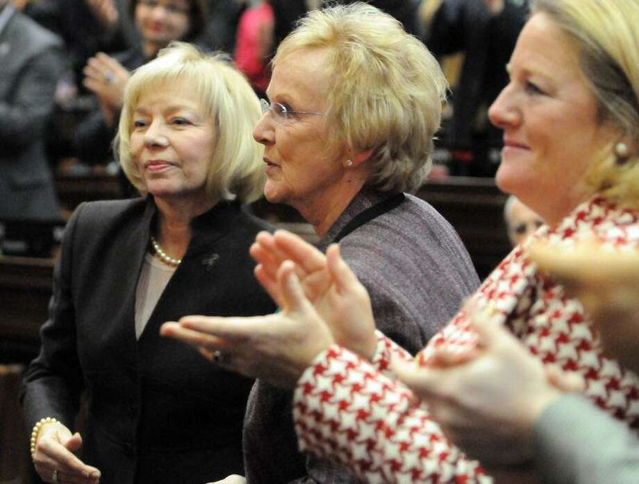 "Led by the applause of Cathy Malloy, wife of Governor Dannel P. Malloy, far right, Newtown School Superintendent Dr. Janet Robinson, left, and Newtown First Selectwoman Pat Llodra,  center, receive a standing ovation during Governor Dannel P. Malloy's 2012 State of the State Address in the Hall of the House at the State Capitol Tuesday, January 09, 2013 in Hartford, Connecticut. Malloy said of the two, ""Tested by unimaginable tragedy, your compassion and leadership over the past month has been an inspiration to Connecticut, and to me personally.""  Photo by Peter Hvizdak / New Haven Register Photo: New Haven Register / ©Peter Hvizdak /  New Haven Register"