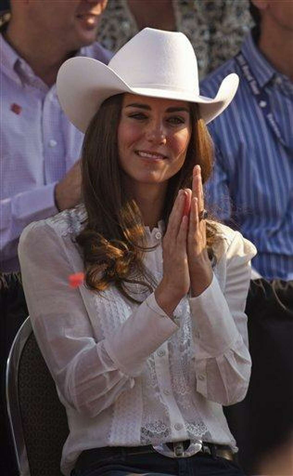 In this July 8, 2011 file photo, Kate, the Duchess of Cambridge, watches the Calgary Stampede parade in Calgary, Canada as the Royal couple continue their Royal Tour of Canada. The Duchess of Cambridge is turning 30 on Monday - but royal fans expecting a lavish birthday bash to mark the milestone will be disappointed. Associated Press