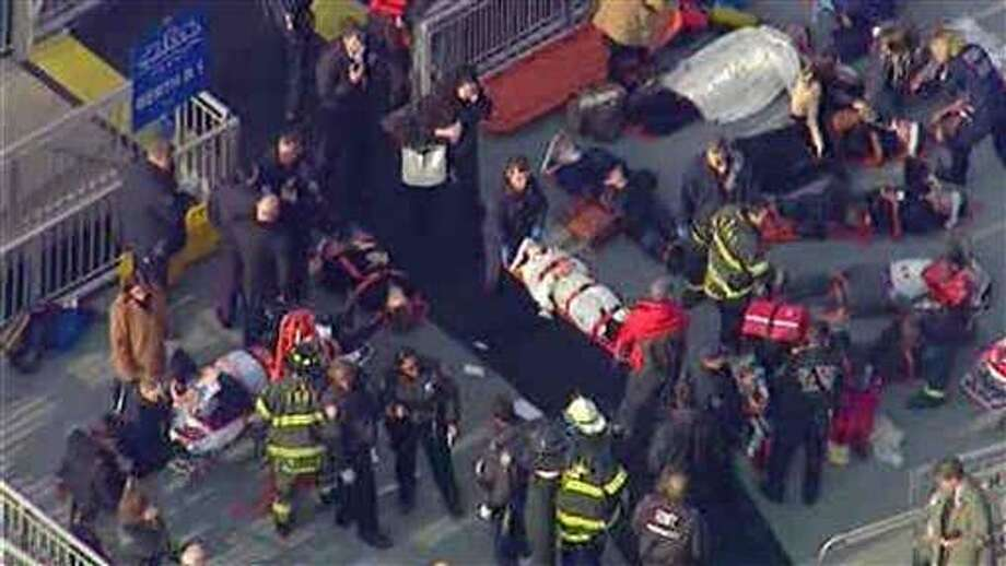 This aerial photo provided by WABC News Channel 7 shows emergency personnel at the scene of a ferry crash in Lower Manhattan, Wednesday, in New York. (AP Photo/WABC News Channel 7) Photo: AP / WABC 7
