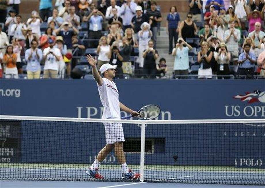Andy Roddick waves to fans after his fourth round loss to Argentina's Juan Martin Del Potro at the 2012 US Open tennis tournament, Wednesday, Sept. 5, 2012, in New York. Roddick said he would retire after the match. (AP Photo/Charles Krupa) Photo: AP / AP