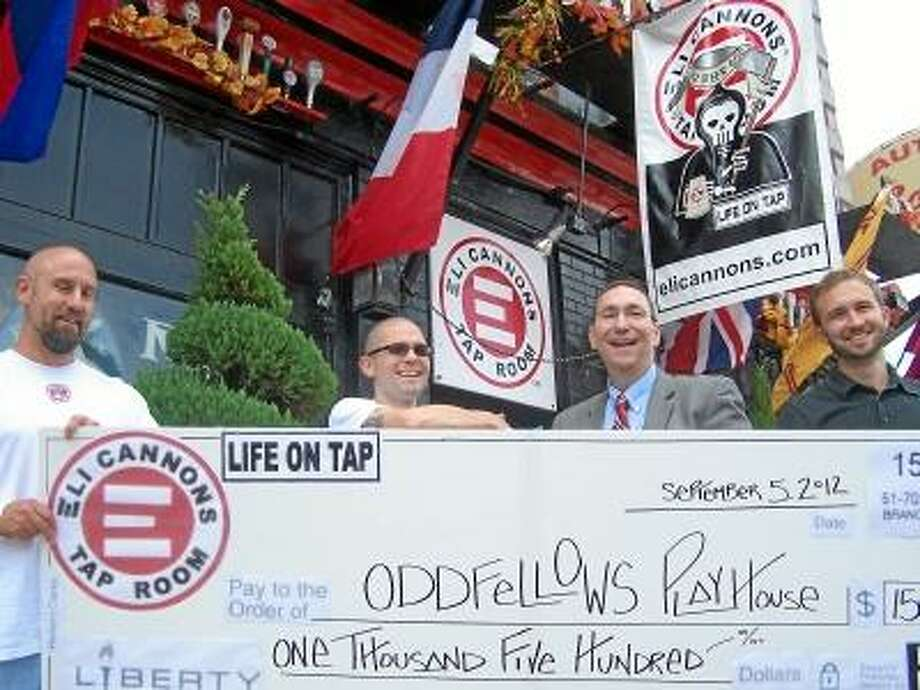 Jim Salemi I The Middletown Press Phil Ouellette, owner of Eli Cannon's Tap Room, Beer Consigliere J.D. Crandall, Mike Sciola, chairman of the Oddfellows Playhouse Board of Directors and Matt Pugliese, executive director of Oddfellows are seen with a check presented to Oddfellows Playhouse Wednesday.