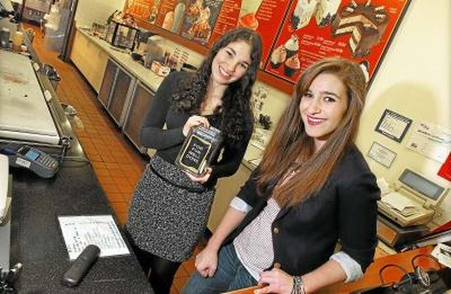 Middletown High School seniors KC Sauer, 17, at right and Lydia Tonkonow, 17, collected over a $1,000 for the Make-A-Wish Foundation selling Make-A-Wish stars and collectively donating their tips for the past year as crew members at Cold Stone Creamery at 100 Riverview Center in Middletown. Sauer and Tonkonow were recognized by the Make-A-Wish Foundation of Connecticut and Mayor Daniel Drew proclaimed today as Lydia Tonkonow and KC Sauer Day in Middletown.  Catherine Avalone/The Middletown Press