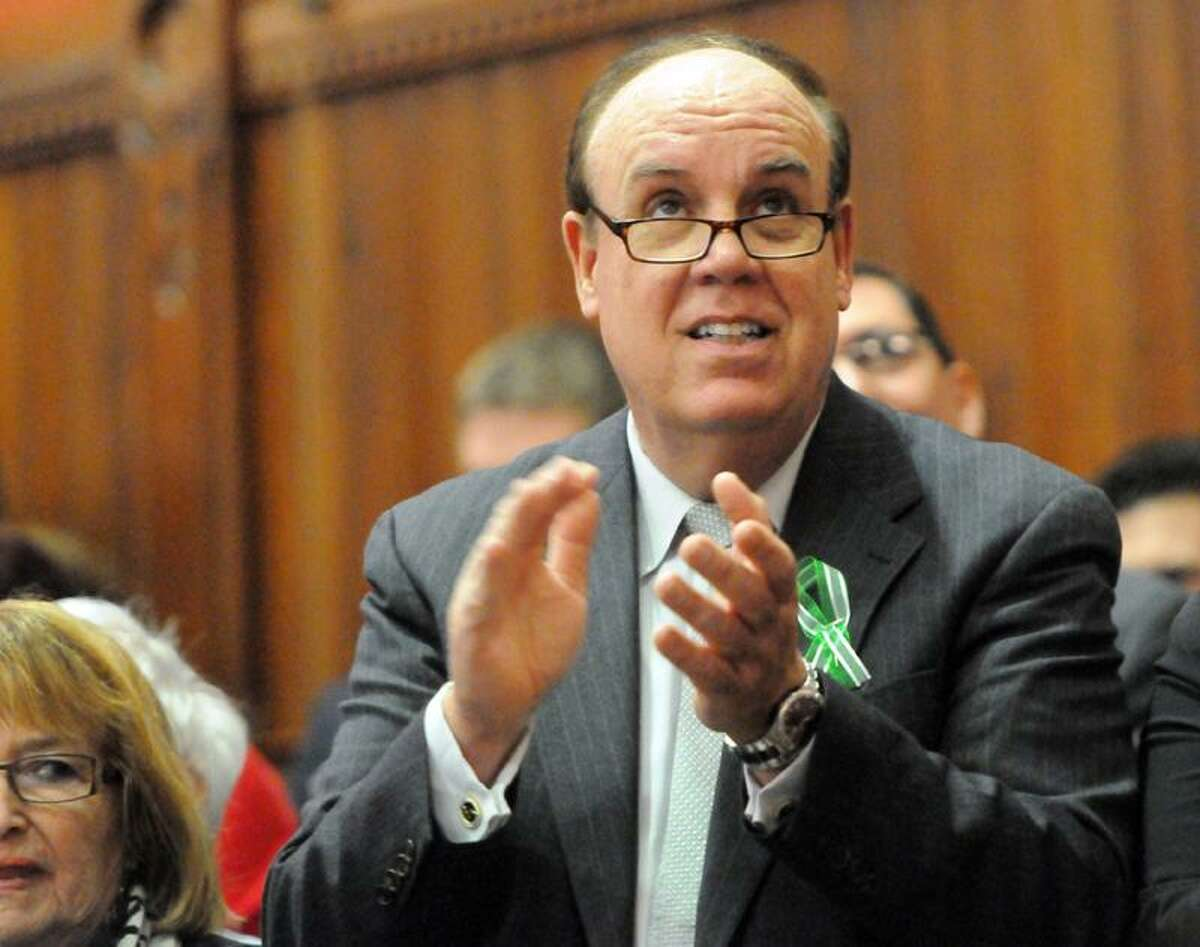 Democratic State Representative Steve Dargan of West Haven, Conn., who wants to make names of Connecticut Pistol Permit holders public information, applauds before Connecticut Governor Dannel P. Malloy gives the 2013 State of the State Address in the Hall of the House at the State Capitol Tuesday, January 09, 2013 in Hartford, Connecticut. Photo by Peter Hvizdak / New Haven Register