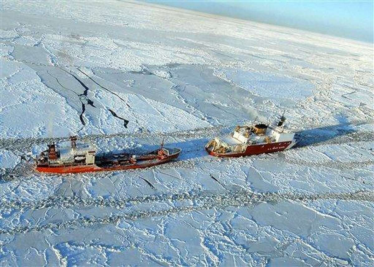 The Coast Guard Cutter Healy opens a path in the ice for the Russian-flagged tanker Renda 250 miles south of Nome Friday. The vessels are making their way through ice up to five feet thick in this area. The 370-foot tanker Renda will have to go through more than 300 miles of sea ice to get to Nome, a city of about 3,500 people on the western Alaska coastline that did not get its last pre-winter fuel delivery because of a massive storm. Associated Press