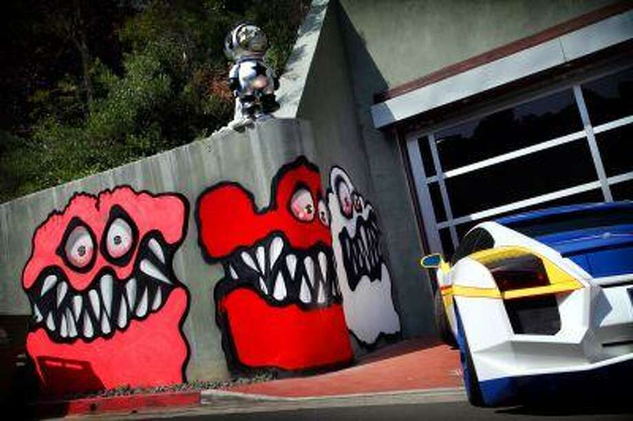This May 10, 2013 photo shows Graffiti painted on the walls of the home of entertainer Chris Brown in Hollywood Hills, Calif. Photo: AP / Los Angeles Times
