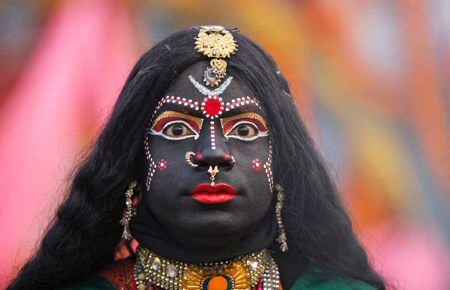 A man, dressed as Hindu Goddess Kali, participates in a religious procession towards the Sangam, the confluence of rivers Ganges, Yamuna and mythical Saraswati, as part of the Mahakumbh festival in Allahabad, India, Sunday, Jan. 6, 2013. Millions of Hindu pilgrims are expected to take part in the large religious congregation on the banks of Sangam during the Mahakumbh festival in January 2013, which falls every 12th year. (AP Photo/Rajesh Kumar Singh) Photo: AP / AP