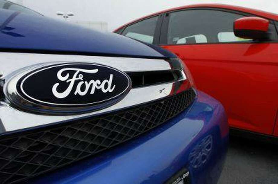 The Ford logo is seen on cars for sale at a Ford dealership Sunday, July 1, 2012 in Springfield, Ill. Photo: ASSOCIATED PRESS / AP2012