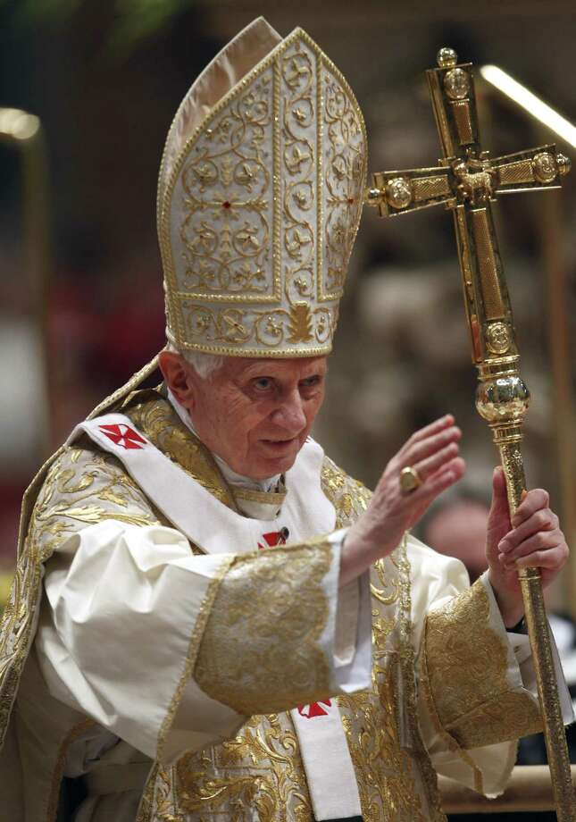 Pope Benedict XVI waves to faithful as he arrives to celebrate the Epiphany Mass in St. Peter' s Basilica at the Vatican Friday. Pope Benedict XVI named 22 new cardinals Friday, including prelates in such key posts as New York and Hong Kong and a large group of Italians holding major Vatican positions. Cardinals are the pope's top advisers, the elite group of churchmen who will eventually elect Benedict's successor. (AP Photo/Pier Paolo Cito) Photo: AP / AP