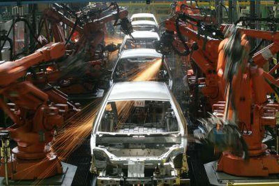 ADVANCE FOR USE SUNDAY, MAY 12, 2013 AND THEREAFTER - In this March 6, 2008 photo, Ford Ka cars are assembled in Sao Bernardo do Campo, Brazil. The Ford Ka hatchback sold in Europe scored four stars when it was tested by Euro NCAP in 2008; its Latin American version scored one star. Ford acknowledged that particular Ka is built on an outdated platform, and said it cannot be compared with the European version of the same name. More than 10,000 cars roll off the local assembly lines of the industry's biggest automakers a day. The country is now the fourth largest auto market in the world. But experts say thousands of Brazilians are dying every year in auto accidents that in many cases shouldn't have proven fatal. (AP Photo/Andre Penner) Photo: AP / AP