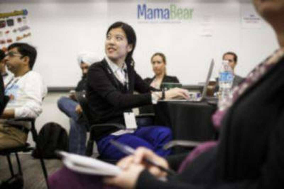 Cyrena Chih, a product manager at Duck Duck Moose, a maker of educational mobile applications for children, listens to a speaker during the MamaBear family tech conference at the Microsoft campus in Mountain View on May 10, 2013.