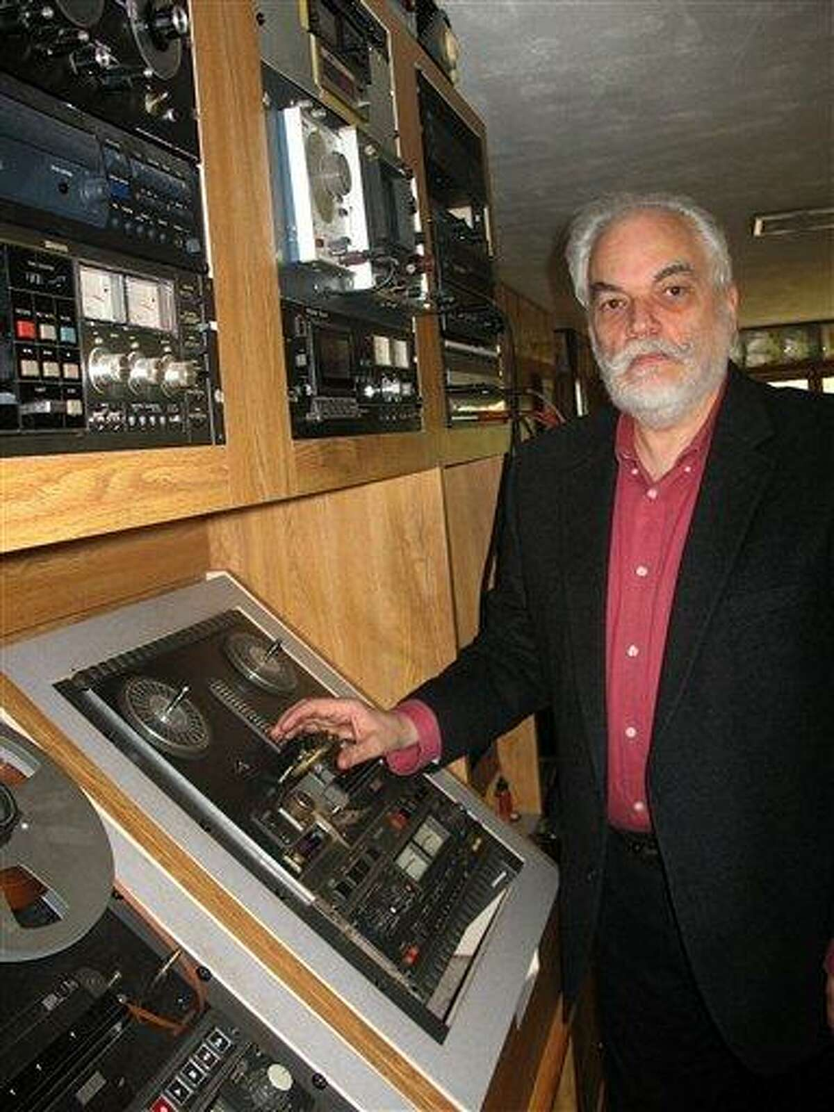 J. David Goldin, shows his radio collection April 30 in Sandy Hook, Conn. Goldin spotted on eBay a record he'd donated to the National Archive in the 1970s, setting off an investigation. Associated Press
