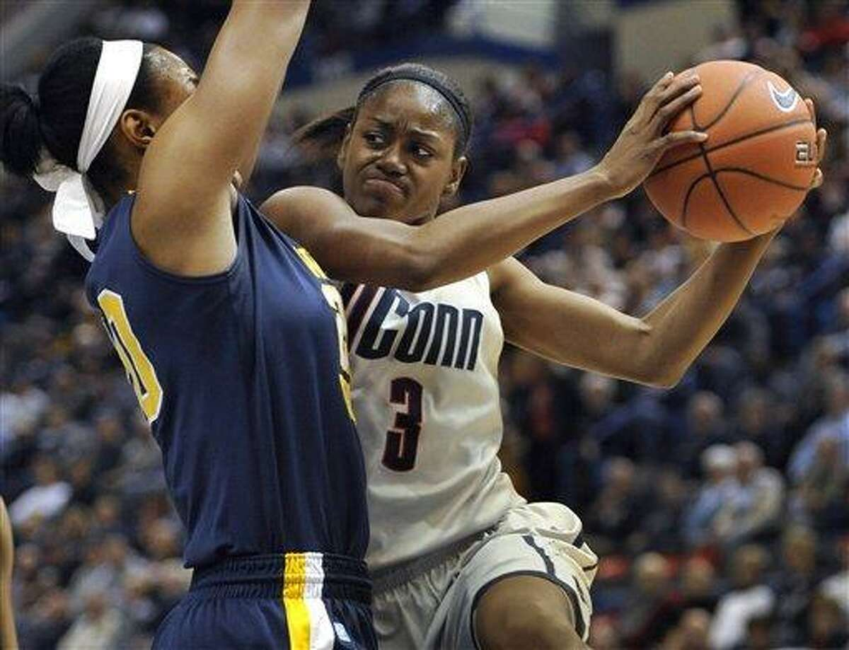 Connecticut's Tiffany Hayes, right, drives to the basket while guarded by West Virginia's Asya Bussie, left, first half of an NCAA college basketball game in Hartford, Conn., Wednesday, Jan. 4, 2012. (AP Photo/Jessica Hill)