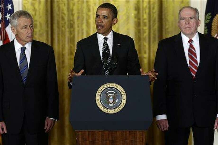 President Barack Obama announces in the East Room of the White House in Washington, Monday, Jan. 7, 2013, that he is nominating Deputy National Security Adviser for Homeland Security and Counterterrorism, John Brennan, right, as the new director of the CIA; and former Nebraska Sen. Chuck Hagel, left, as the new Defense Secretary. (AP Photo/Charles Dharapak) Photo: AP / AP