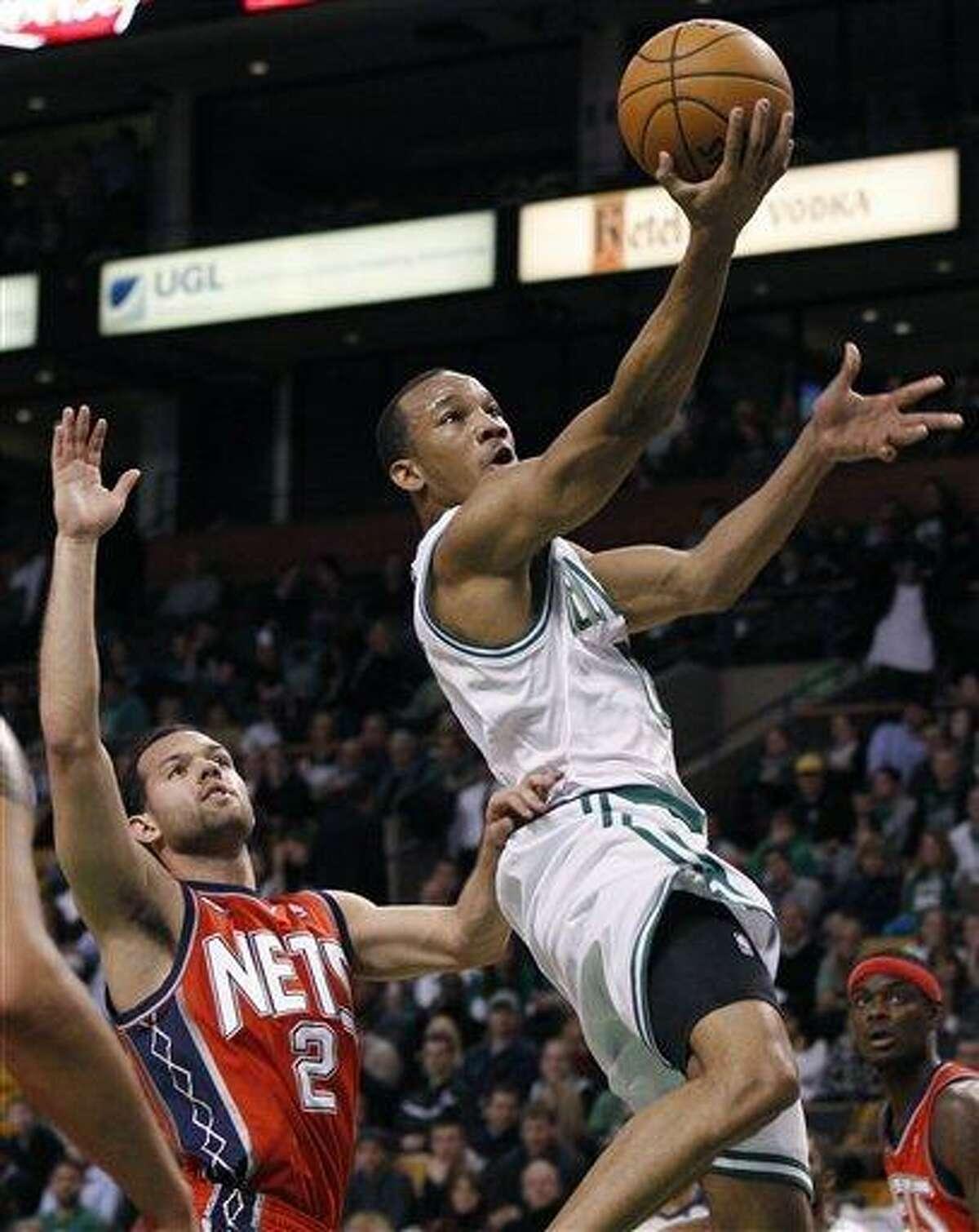 Boston Celtics guard Avery Bradley drives past New Jersey Nets guard Jordan Farmar (2) in the second half of an NBA basketball game in Boston, Wednesday, Jan. 4, 2012. The Celtics won 89-70. (AP Photo/Elise Amendola)