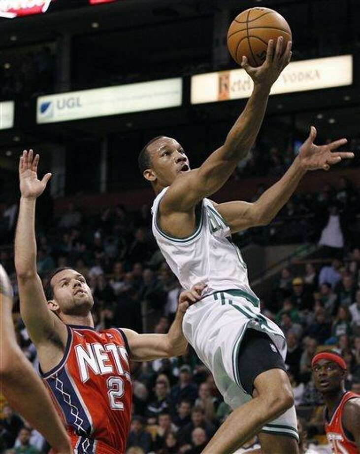Boston Celtics guard Avery Bradley drives past New Jersey Nets guard Jordan Farmar (2) in the second half of an NBA basketball game in Boston, Wednesday, Jan. 4, 2012. The Celtics won 89-70. (AP Photo/Elise Amendola) Photo: AP / AP