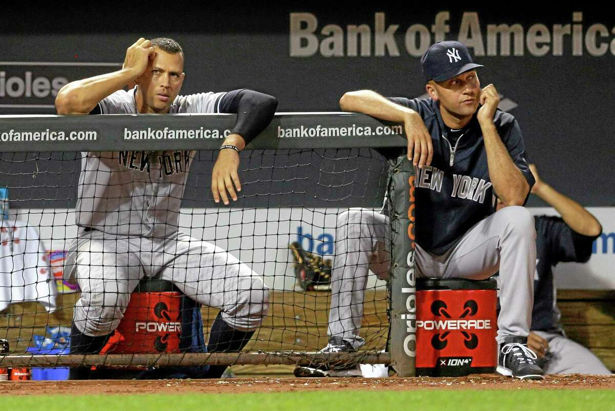 Derek Jeter, right, and Alex Rodriguez watch from the dugout during the Yankees' game against the Baltimore Orioles on Wednesday.